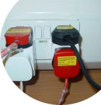 Picture of over loaded electrical sockets